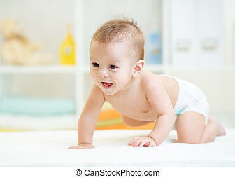 crawling baby - baby boy weared diaper crawling on bed at...