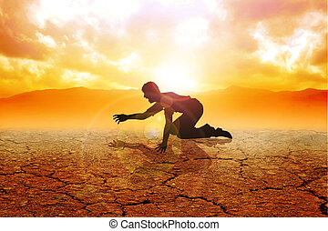 Crawling - Silhouette of a man crawling on arid land