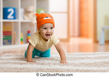 crawling kid or child at home on carpet - baby boy at home...
