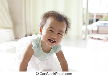 crawling of 10 month baby with funny face