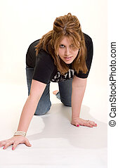 Crawling - young woman wearing a black t-shirt and jeans...
