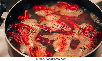 Crayfish are boiled in a pot.