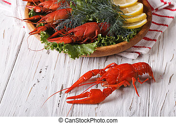 crayfish boiled with herbs on a table close-up. horizontal