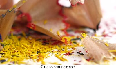 Crayon shavings on white, close up, slow motion