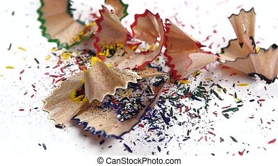 Crayon shavings on white, slow motion - Crayon shavings on...