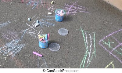 crayons for drawing lying on the pavement.