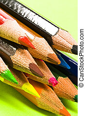 Crayons on green background