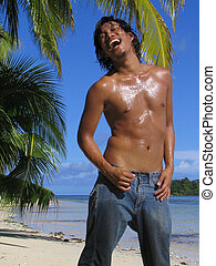 Crazily happy Asian boy - Shirtless Asian boy in jeans on...