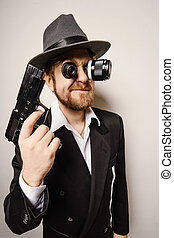 crazy beard detective whit gun in hat