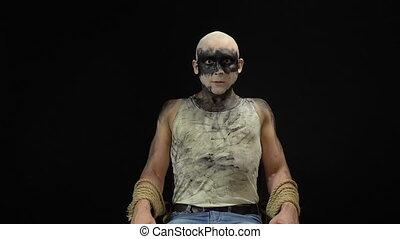 Crazy binding man - Footage of binding madness man on black...