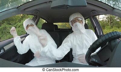 Crazy biohazard scientists technicians in hazmat suits...