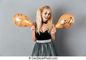 Crazy blonde woman in clown make-up