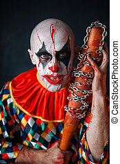 Crazy bloody clown with baseball bat