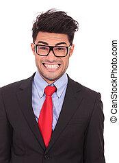 crazy business man shows teeth - closeup portrait of a crazy...