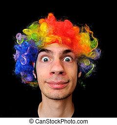 Crazy Clown - A silly crazy man wearing a clown wig with...