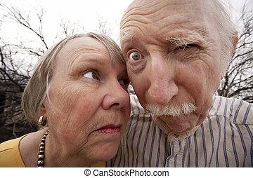 Closeup portrait of crazy elderly couple outdoors