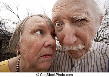 Crazy Couple - Closeup portrait of crazy elderly couple...