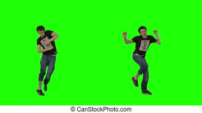 A guy dances energetically against green-screen. 2 shots combined. Shot on RED.
