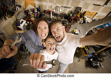 Family in garage do it yourself family in their garage pictures crazy do it yourself family with wrenches solutioingenieria Image collections