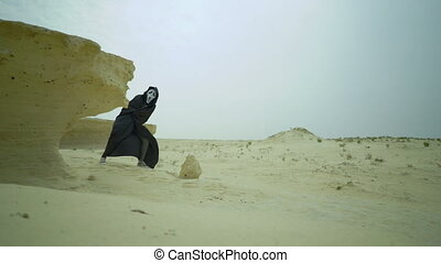 Crazy funny scary man walks, run, jumps in the desert, lost...