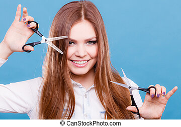 Crazy girl with scissors. Hairdresser in action.