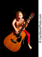 An enthusiastic boy playing guitar.