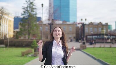 Crazy happy businesswoman dancing in street town corporate celebrating achievement