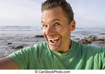 Crazy happy selfie pic at beach - Closeup selfie photo of...
