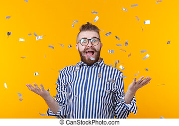 Crazy joyful cheerful young man in a glasses on a yellow background. The concept of a successful party and holiday.