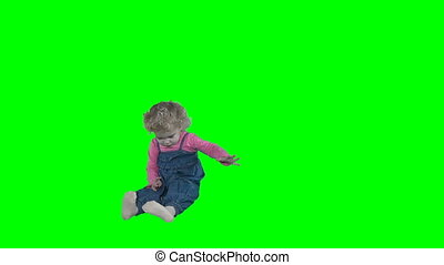 Crazy little child girl romp dance move isolated on green...