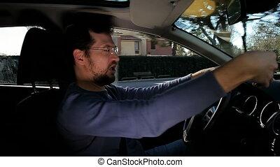 Crazy man doing selfie in car