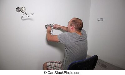 Crazy man get electric shock. Guy shake holding cable....