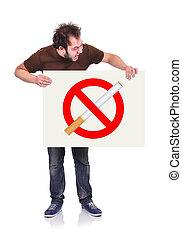 stop smoking - crazy man holding signboard with stop smoking