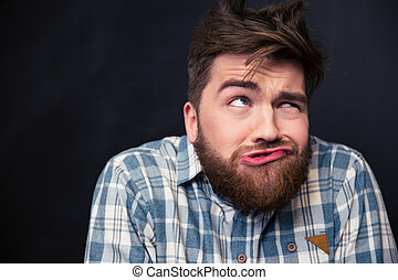 Crazy man joking and grimacing over black background