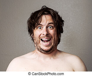Crazy Man looking at the camera - Topless man making a...