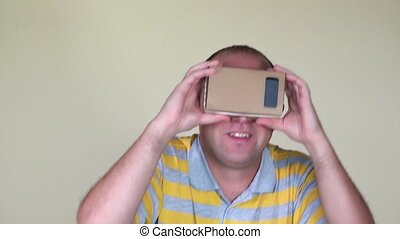 Crazy man playing with virtual reality vr glasses. closeup