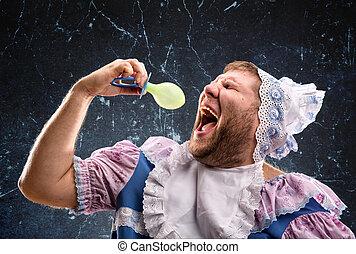 Crazy man sucking a pacifier