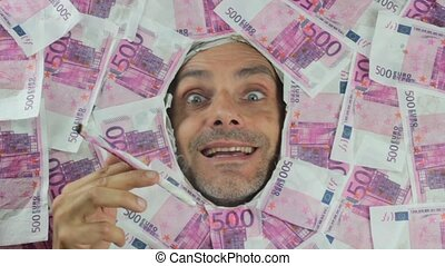 crazy man with papermoney cigarette