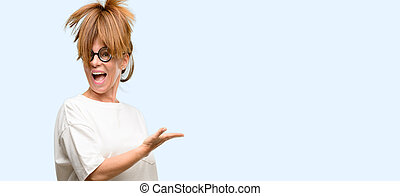 Crazy middle age woman wearing silly glasses holding something in empty hand