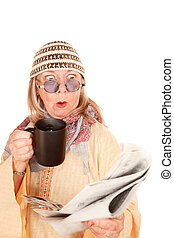 Crazy new age woman in a yellow robe with coffee