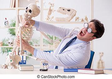 Crazy professor studying human skeleton