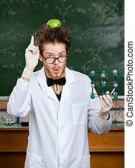 Crazy scientist with an apple on his head shows forefinger...