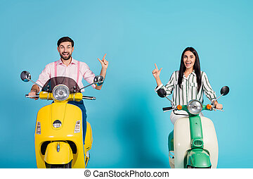 Crazy surprised shocked two people bikers drive power motor bike look incredible ads follow point index finger copyspace scream wow omg wear formalwear shirt isolated over blue color background