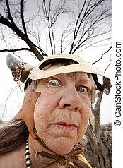 Crazy old woman wearing a Viking helmet