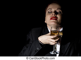 crazy woman in a man's suit drinks champagne, wildly laughs
