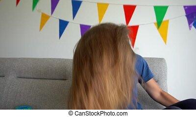 Crazy woman shake long hair and show tongue look at camera. Gimbal slow motion
