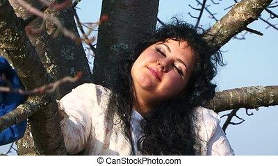 Crazy Woman Sitting On Tree