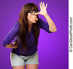 Crazy Woman With Stick Out Tongue Isolated On Purple Background