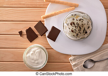 Cream and choco ice cream cup decorated with chips top