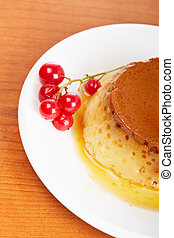 Cream caramel dessert with red currants - Close-up of a...